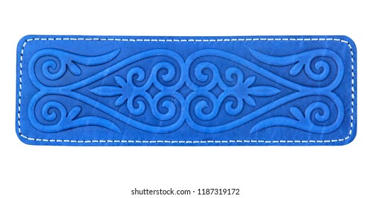 Wallet in Asian style. Blue embossed leather, Kazakh traditional ornament. Closeup, isolated, selective focus