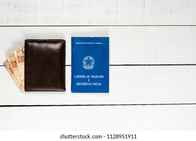 Wallet with Brazilian money notes and work permit on white background pinus