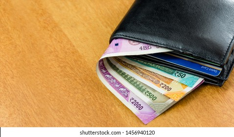 Wallet with cash and credit Card indian currency background Payment earnings theme