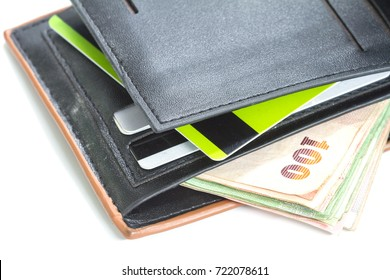 Wallet with credit cards and Thai banknotes on white background, money concept