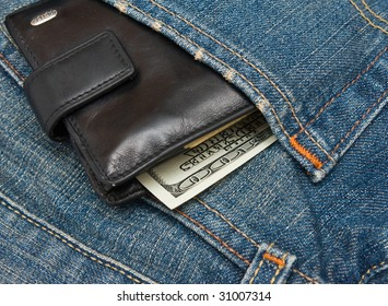 Wallet with dollar bank notes in jeans pocket