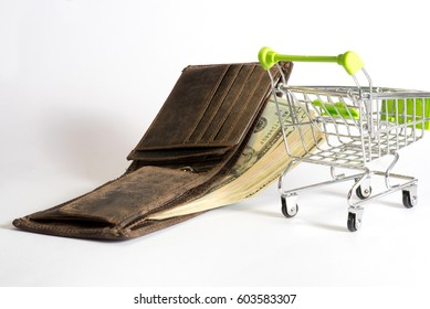 Wallet, dollar bills and a shopping cart
