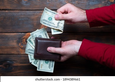 Wallet with dollars in men's hands.  - Shutterstock ID 1894389661