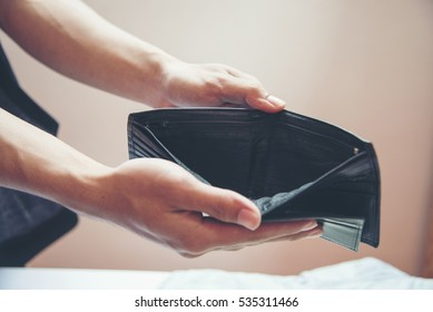 Wallet Empty when business people are poor. Unemployed man showing empty wallet. Close up hands of poor man open empty purse. bankrupt background poor homeless.