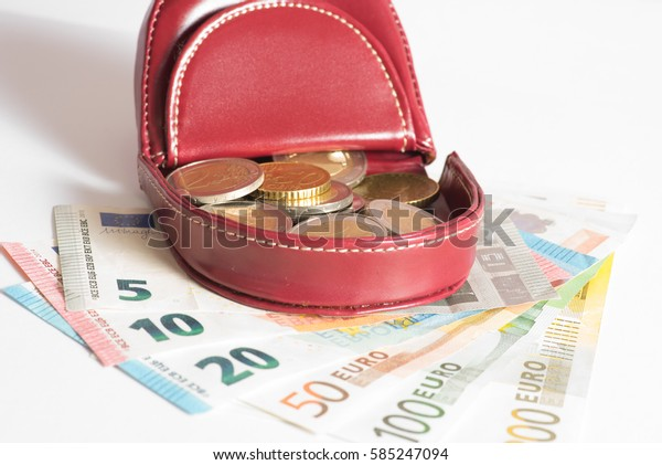 A wallet and Euro money