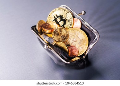 Wallet filled with two Bitcoin and many Euro coins