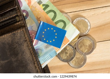 A wallet, flag of European Union EU and Euro bills and coins