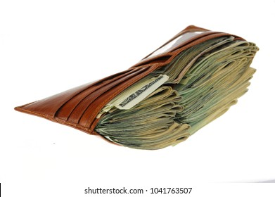 Wallet full of US dollar cash bills