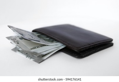 Wallet with indian money isolated on white.