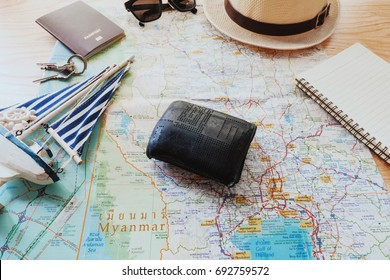 Wallet and map travel trip destination direction planning concept.