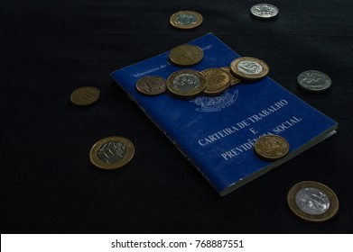 wallet of work brazilian with coins with the inscripition ministry of labour and employment republic of Brazil fifteen thousand november and eight hundred eighties and nine wallet of work and social