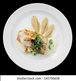 Walleye fillet with artichokes and molecular broth on black background