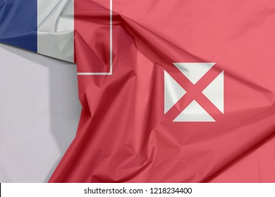 Wallis and Futuna fabric flag crepe and crease with white space, red saltire on a white square, the flag of France in the upper.
