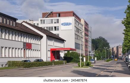 Wallisellen, Switzerland - 4 August, 2014: International School and Reishauer buildings on the Richtistrasse street. Wallisellen is a municipality in the canton of Zurich in Switzerland.