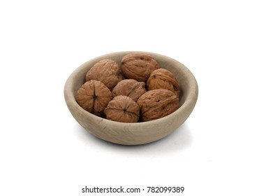 Wallnuts in a bowl, isolated on white