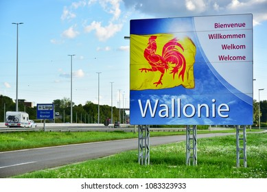 WALLONIA, BELGIUM - AUGUST 14, 2017: Welcome signboard with the Flag of the Belgian region of Wallonia in Belgium.