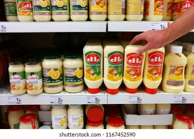 WALLONIA, BELGIUM - AUGUST 4, 2018: Shelves with various brands of Mayonnaise in a Carrefour supermarket.
