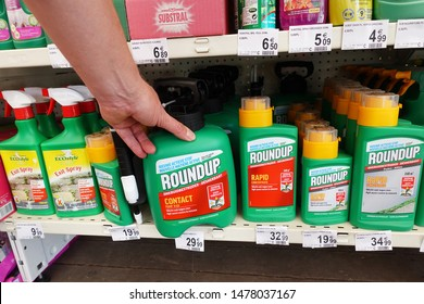 WALLONIA, BELGIUM - JULY 24, 2019: Herbicides in a Carrefour Hypermarket. Roundup is a brand-name made by Monsanto, owned by Bayer. New in 2019 is that Roundup no longer contains glyphosate.