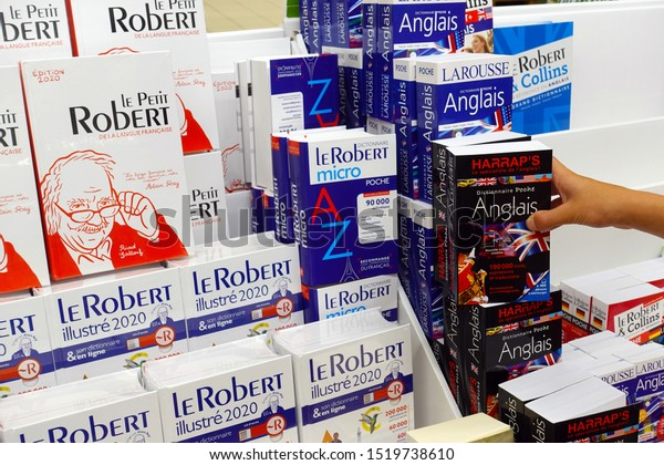 WALLONIA, BELGIUM - JULY 24, 2019: Assortment bilingual dictionaries in a Carrefour Hypermarket. Le Petit Robert is a popular single-volume French dictionary.