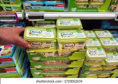 WALLONIA, BELGIUM - JULY 26, 2019: Margarine tubs in a shop. Becel is a brand of margarine produced by Upfield, a company selling multiple brands of margarine and other food spreads.