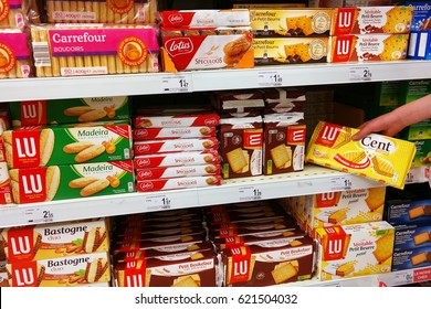 WALLONIA, BELGIUM - MAY 6, 2016: Cookies aisle. Shopping in the biscuits section of a Carrefour supermarket in Belgium. LU, Lefèvre Utile is a manufacturer brand of French biscuits, owned by Mondelez.