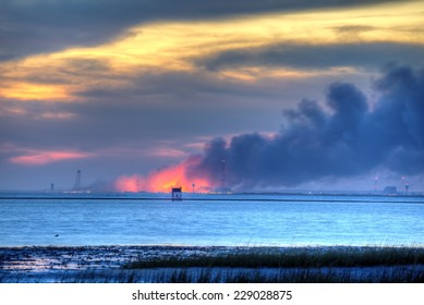 WALLOPS ISLAND, VIRGINIA - OCTOBER 28: An Orbital Sciences Corp. rocket burns on the ground at NASA's Wallops Flight Facility on October 28, 2014.  The rocket exploded a few seconds after launch.