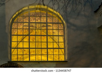 The wall-paintings in the ceiling of Ronneby church, seen through a window a cold winter evening, Ronneby, Sweden, December 6, 2017
