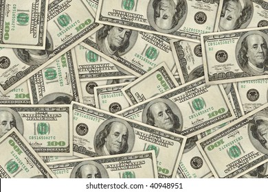 wallpaper of 100 dollar bills randomly placed. high resolution.