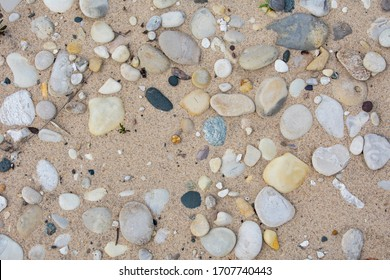Wallpaper of beach rocks on lake Michigan's lower peninsula shore in Sleeping Bear Dunes National Lakeshore. Many rocks are unique to Michigan including the Petoskey Stone. Stones not tightly packed.