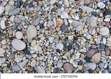Wallpaper of beach rocks on lake Michigan's lower peninsula shore in Sleeping Bear Dunes National Lakeshore. Many rocks are unique to Michigan including the Petoskey Stone. Rocks tightly packed.