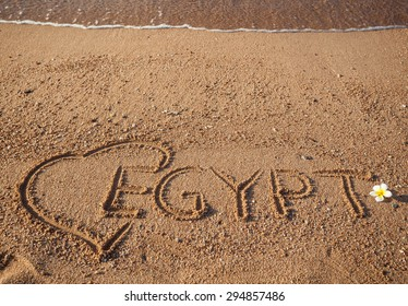 Wallpaper, the Red  Sea holidays background. Inscription Egypt and exotic flower  on the sand. Love Egypt
