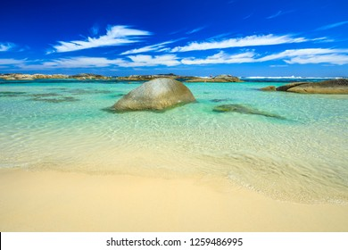 Wallpaper sea background. Sheltered waters of Greens Pool in William Bay NP, Denmark, Western Australia. Tropical landscape of popular Australian travel destination. Sunny summertime. Copy space.