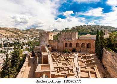 The walls of the Alcazaba in the Alhambra and the panorama of Granada. In the background is the Sierra Nevada mountain range. Granada, Spain
