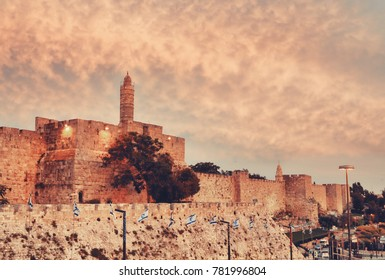 Walls of Ancient City at sunset, David's tower and citadel, Jerusalem, Israel. Vintage filter applied.