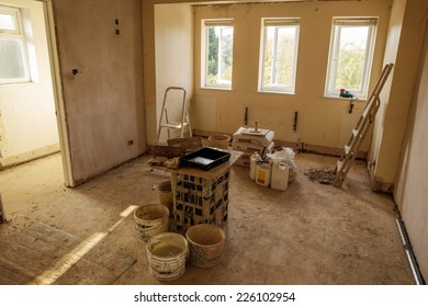 walls and ceiling being plastered