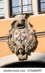 Walls decorated with coats of arms and statues in old town of  Regensburg, Germany
