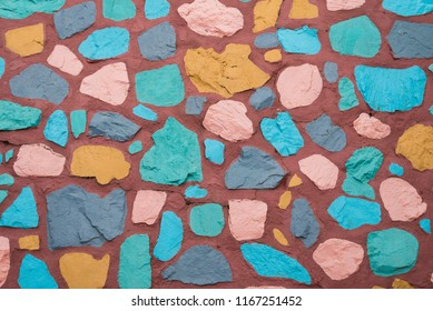 The walls are decorated with colorful stones.