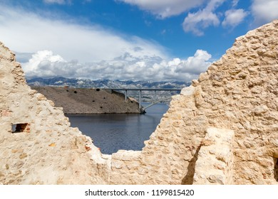 Walls of fortress and the Pag bridge, Island of Pag, Croatia, Europe