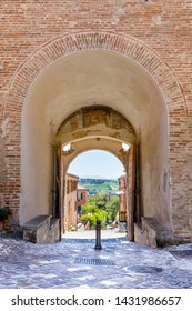 Walls of Gradara. Gate with a view through a arch. The medieval castle-fortress of Gradara, Marche, Italy.