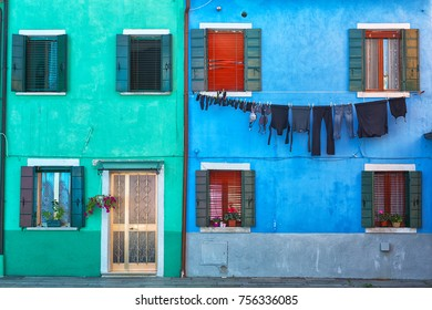 walls of the houses painted with bright colors paints on Buranos island, Venice, Italy