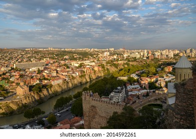 Walls of the Narikala fortress and houses on a cliff at Kura River in the old town. Tbilisi, Georgia - Shutterstock ID 2014592261