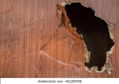 The walls are plywood with a hole.