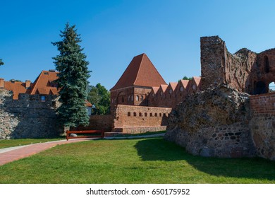 Walls and remains of the medieval Torun Castle in the old town of Torun, Poland