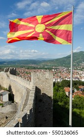 Walls and towers of Samuel's fortress with waving flag of Macedonia, Ohrid, FYROM