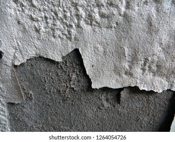 Walls where the wall color is decaying. Wall decay, Background decay. White concrete paint crack wall texture background.