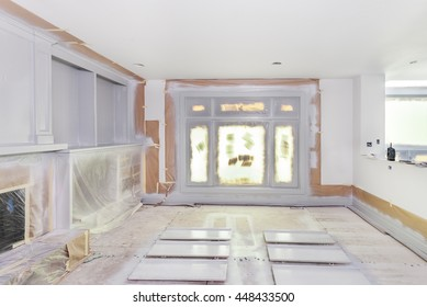 Walls and windows masked with paper and plastic as trim and shelves are spray painted