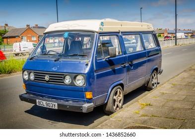 Wallsend, Tyne and Wear / England - June 28 2019: Well used blue Volkswagon campervan in Wallsend, North Tyneside.