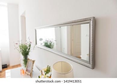 wallway mirror on wall. decorative mirrow on wall.
