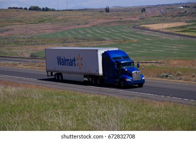 """Wal-Mart""  A Blue Kenworth Semi-Truck pulls a white branded trailer along a rural Oregon Highway.  June 20th, 2017 Rural Oregon, USA"