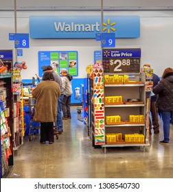 Walmart retail store customers wait in cashier check out lanes, Saugus Massachusetts USA, January 25, 2019